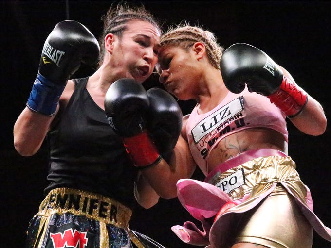 Jennifer Han exchanges punches with Lizbeth Crespo
