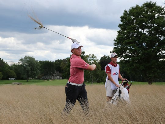Brad Dalke hits his shot to the sixth green from the