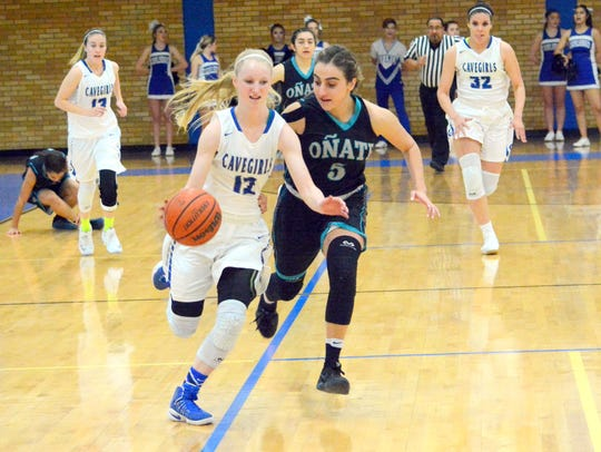 Carlsbad's Carsyn Boswell gets a steal and bolts toward