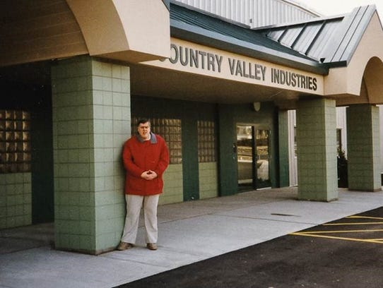 Jim Holic stands outside of Country Valley Industries,