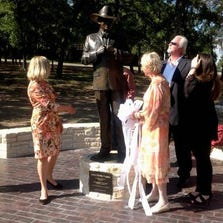 From left, Larry Hagman's daughter Kristina, his sister, Heller, son Preston and niece Dana Hagman at a new statue in the actor's honor.