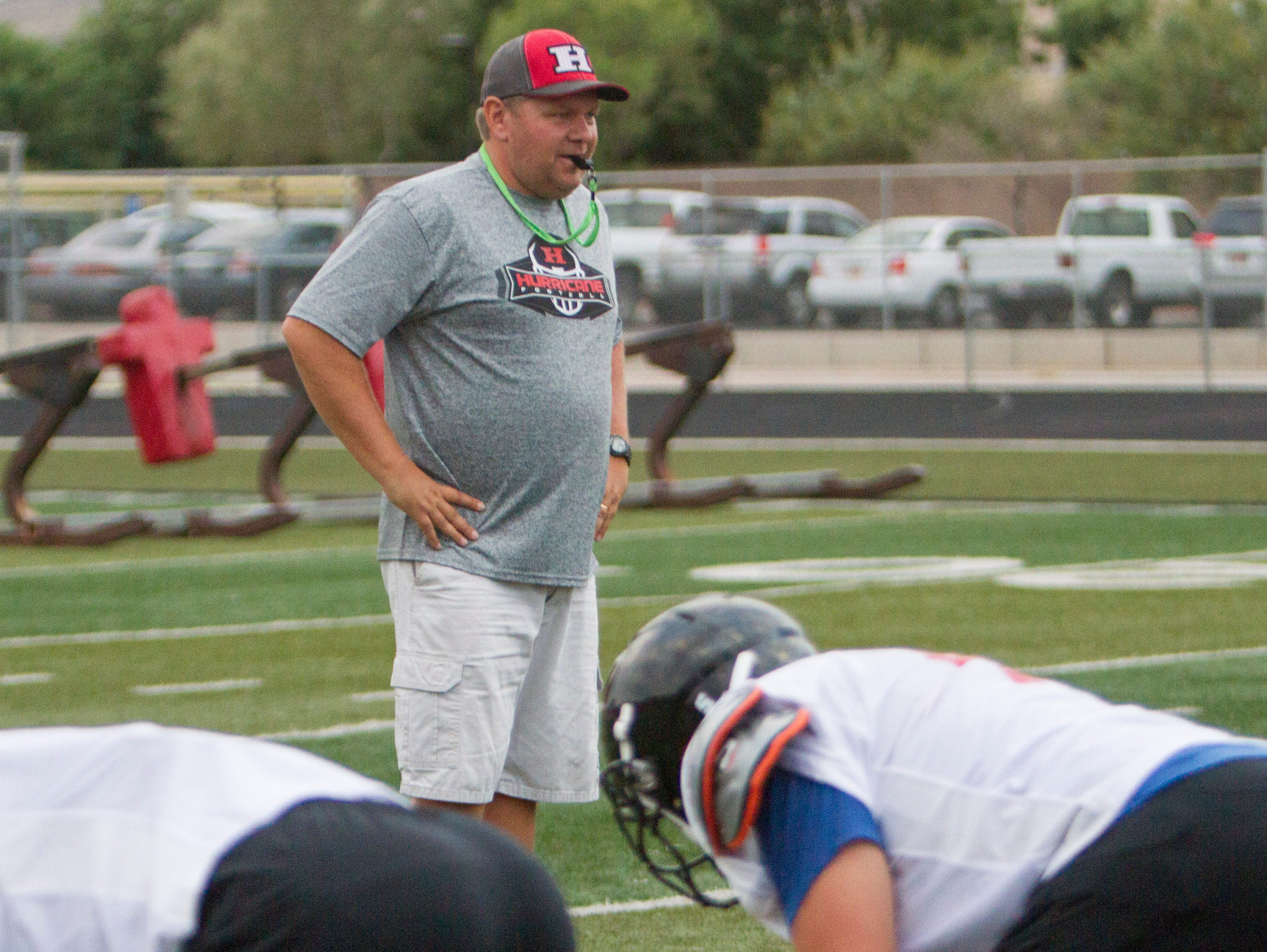 Hurricane head football coach Steve Pearson watches his team practice Thursday, August 4, 2016. The Tigers open the season at home against Skyline on Friday at 7 p.m.
