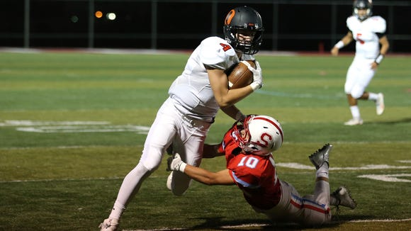 South Salem's Collin Vogt tries to take down Sprague's Max Long in a Greater Valley Conference game on Friday, Sept. 2, 2016, at South Salem. Sprague defeated South Salem 48-7.