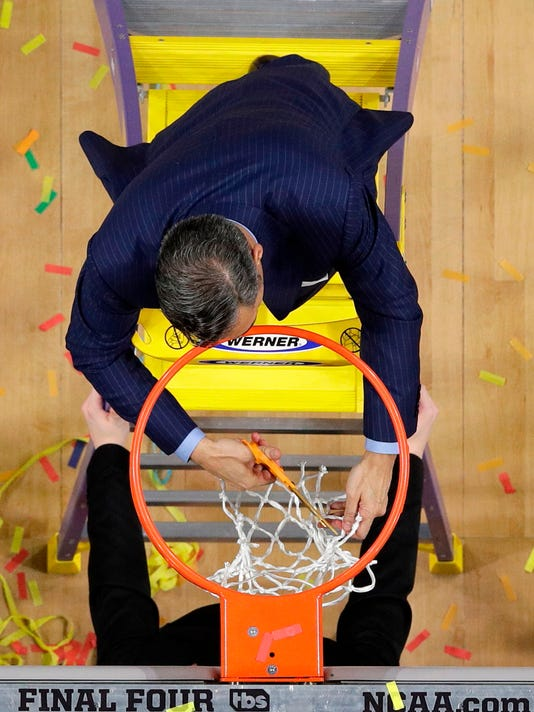 Villanova head coach Jay Wright cuts the net as he celebrates after the championship game of the Final Four NCAA college basketball tournament against Michigan, Monday, April 2, 2018, in San Antonio. Villanova won 79-62. (AP Photo/Morry Gash)