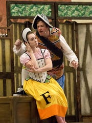 """Emily Sullivan plays Mistress Ford in Cincinnati Shakespeare Company's touring production of """"The Merry Wives of Windsor."""" Seen with her is James Alexander, who plays Falstaff. The show will be performed in repertory with """"Romeo and Juliet"""" through Sept. 3."""