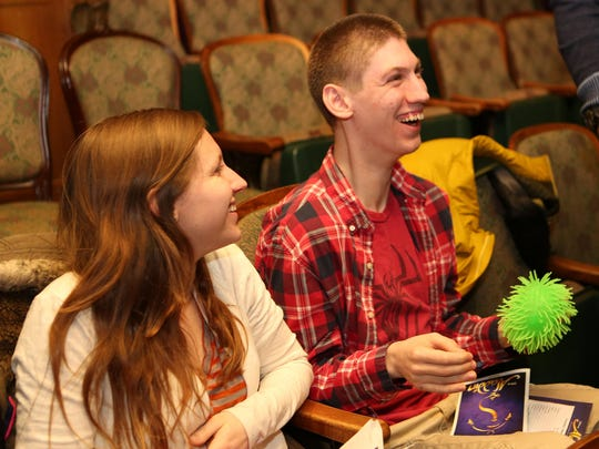 """Raymond Pomeroy, 17, from South Salem, and his sister Emily laugh before an autism-friendly performance of """"Aladdin"""" at Broadway's New Amsterdam Theatre in March."""
