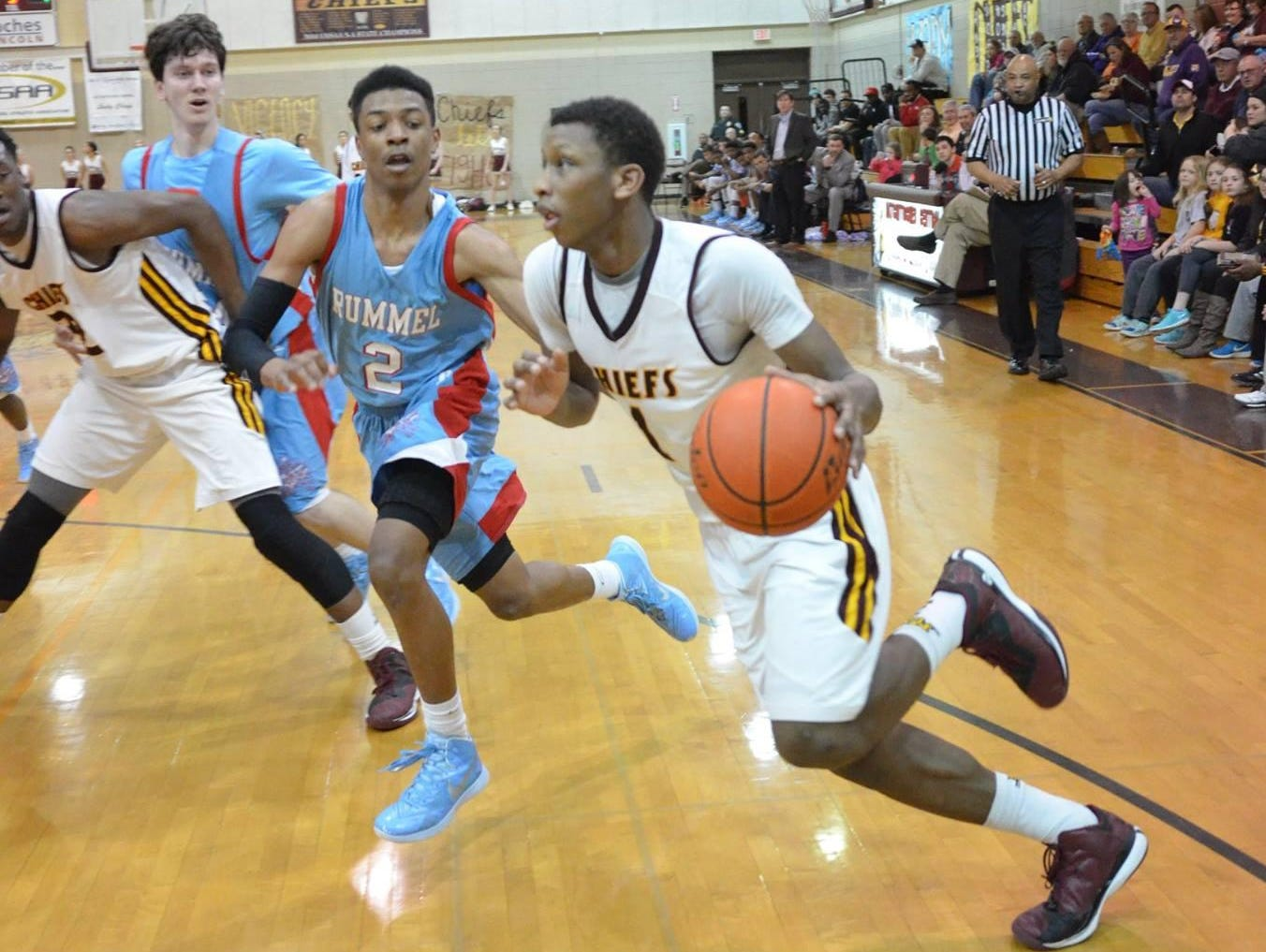 Natchitoches Central junior Brandon Rachal (1, right) drives against Archbishop Rummel.