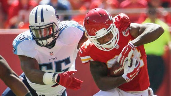 Titans linebacker Zach Brown was injured as he tackled Chiefs running back Knile Davis in the first quarter.