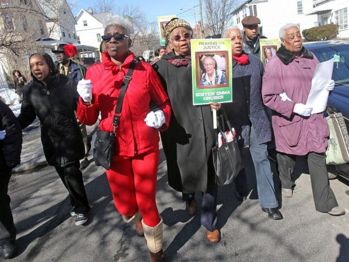 From left, Jannie Humphrey, Lillie Smith, Stephanie Corbett, and Mary Monroe march in Mount Vernon on Feb. 22, 2014 to honor their friend Emma Gruber.  Gruber, 85, was killed in her S. Sixth Street home earlier this month.