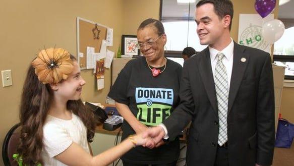 From left, heart transplant recipients Lauren Shields