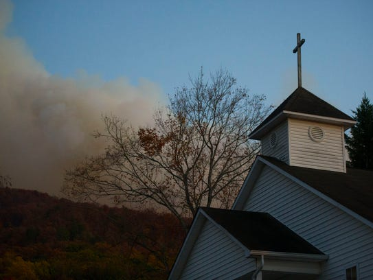 Smoke is seen from a wildfire cresting the top of Chillhowee