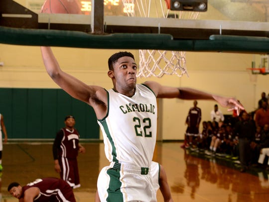 Catholic High School's D.J. Laster dunks the ball in a game against Madison County in 2015. Laster won PNJ Player of the Year in 2015.