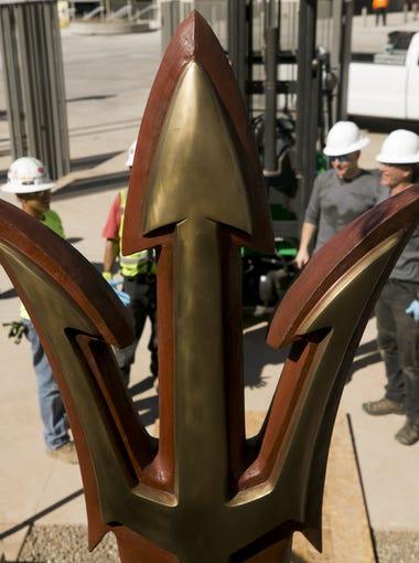 A bronze ASU pitchfork sculpture is installed In the