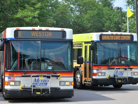Metro Ride buses exchange riders Monday at North Central Health Care in Wausau.