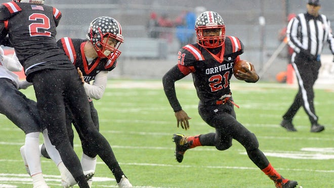 Orrville's Marquel Parks (21) carries the ball against Johnstown during the OHSAA Division V State Championship game on Saturday, Dec. 1, 2018 at Tom Benson Hall of Fame Stadium.