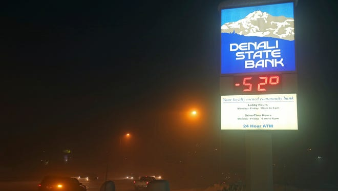 The Denali State Bank sign along Chena Pump Road in Fairbanks, Alaska, reflects the frigid temperatures that have enveloped the interior of the state Wednesday, Jan. 18, 2017.