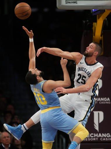 Los Angeles Lakers' Tyler Ennis, left, has his shot