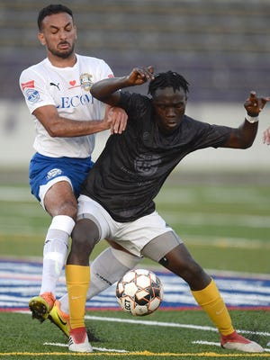 Gabriel Peres, left, of the Erie Commodores and Nuukele Gboe, right, of FC Buffalo battle for the ball during the first day of the Members Cup tournament Friday at Veterans Stadium in Erie.