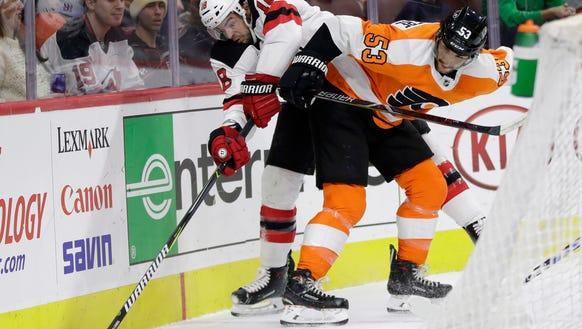 Philadelphia Flyers' Shayne Gostisbehere, right, collides