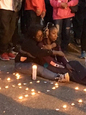 Pyketa Graham (left) embraces her sister Lyketa Graham during a March 30, 2018 candlelight vigil for house fire victims on Inman Cove in Orange Mound. The sisters lost their mother, their grandmother as well as Lyketa Graham's four-year-old son. Their two brothers died Saturday.