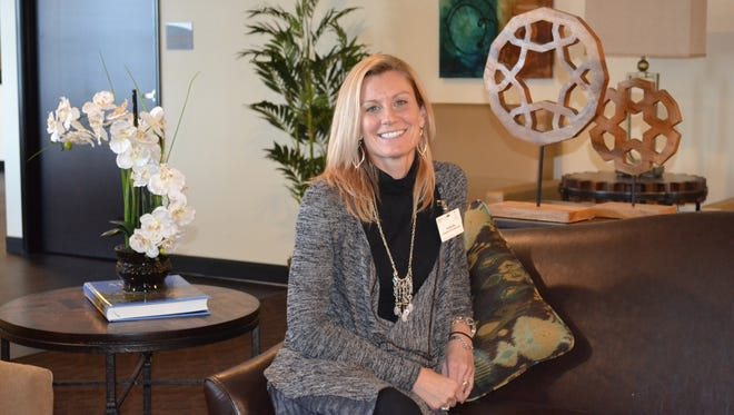 Janelle Ray, Community Services Representative, sits in one of the cozy living rooms at the new Valley View Health Campus. The community areas throughout the facility give residents a place to mingle with other residents or entertain guests.