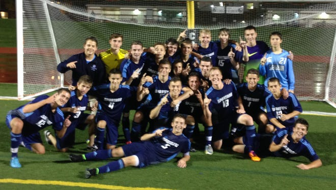 Members of the Livonia Stevenson soccer team celebrate the school's first KLAA Central Division title since 2008 following Thursday night's 6-0 victory over South Lyon East.