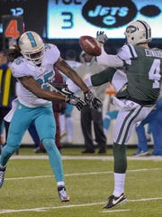 Miami Dolphins free safety Walt Aikens (35) blocks a punt by New York Jets punter Lac Edwards (4) during the third quarter of an NFL football game, Saturday, Dec. 17, 2016, in East Rutherford, N.J. (AP Photo/Bill Kostroun)
