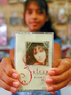 "Angie Soliz, 10, displays Selena's new cassette ""Dreaming of You"" which was released Tuesday, July 18, 1995.  Angie says she has all her albums and saves all magazines and newspapers with stories of Selena.  ""Because me and my sister want to treasure it forever.""  She also said ""I want to be like Selena because she was a big star and everybody loved her.  She was always caring for people.  She wasn't selfish , she was caring and loving."""
