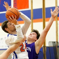 Edison's Kobie Punchard shoots while defended by Kevin Cunningham of Union Springs during Tuesday's game in Elmira Heights.