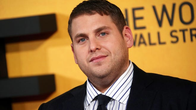"""Jonah Hill, seen at the UK premiere of """"The Wolf of Wall Street,"""" has apologized for shouting a homophobic slur at a paparazzo in an encounter caught on video."""