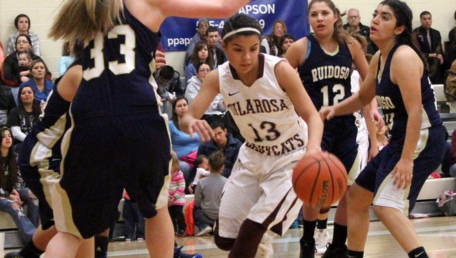 Cassie Vickery drives past Ruidoso's Lia Mosher on Tuesday night at the Michael Dorame Gymnasium.