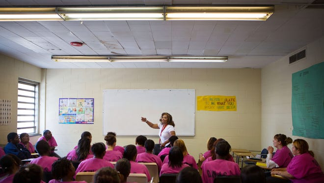 Brenda Myers-Powell, center, leads a meeting of Prostitutes Anonymous, a program that helps women, at the Cook County Jail in Chicago.