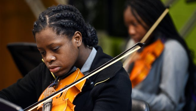 "Isaiah T. Creswell Middle Arts Magnet student Zaris Fears plays ""Thriller"" during strings class on Thursday, Nov. 5, 2015."