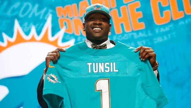 Laremy Tunsil (Mississippi) is selected by the Miami Dolphins as the number thirteen overall pick in the first round of the 2016 NFL Draft at Auditorium Theatre.