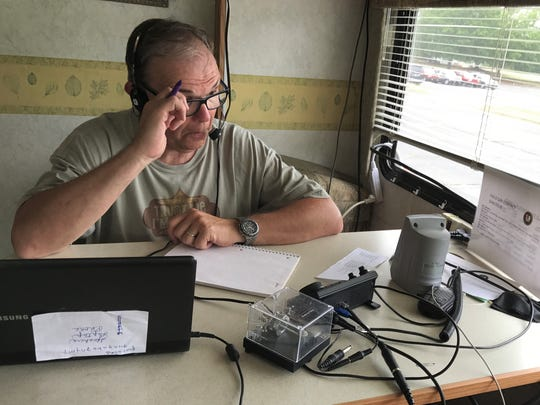 Russell Switzer operates a radio in a trailer in Anderson as part of the 24-hour Radio Field Day.