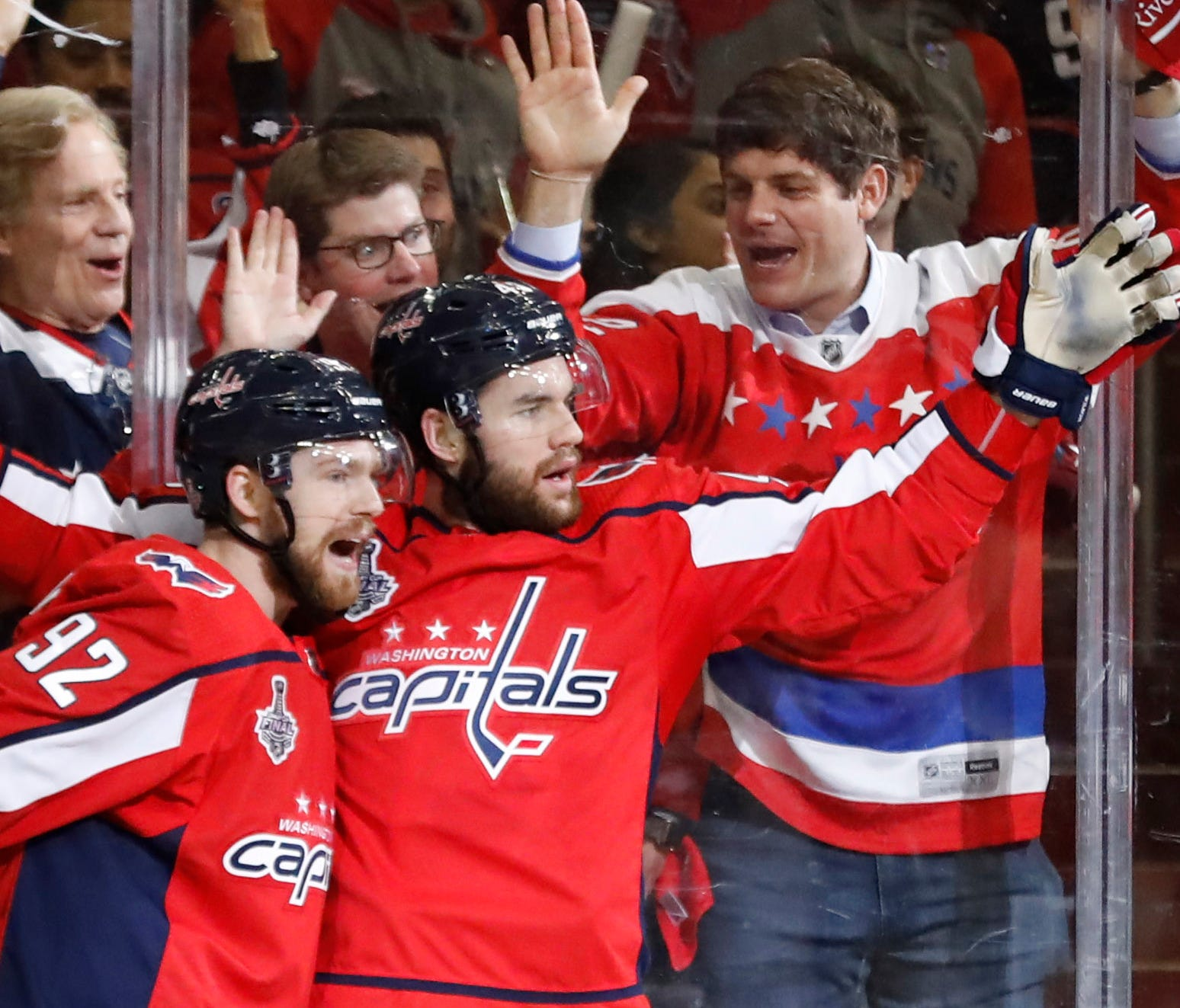 Tom Wilson, right, celebrating with Evgeny Kuznetsov, was one of three Capitals goal scorers in the first period.