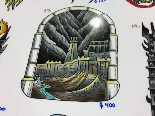 Tattoo prices vary, but this particular one by artist Jake B. is $400 from Golden Rule Tattoo at the Exhibitor Hall of Phoenix Comic Fest, Thursday, May 24, 2018.