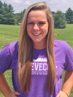 Megan Groves proudly shows off the colors of Trevecca University after her verbal commitment.