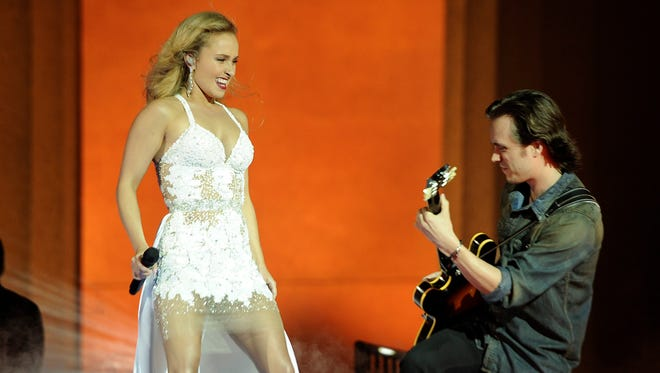 "Hayden Panettiere, left, and Jonathan Jackson film a concert scene for ABC's ""Nashville"" TV show at Centennial Park in 2013."