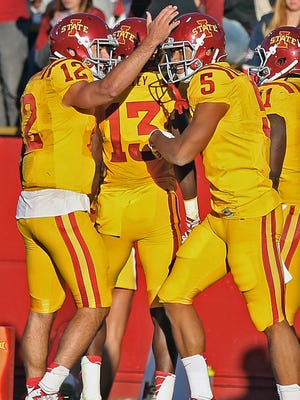 After scoring his team's fourth touchdown against Toledo, Iowa State's Allen Lazard, right, got a pat on the helmet from quarterback Sam Richardson (12) during the game at Jack Trice Stadium.