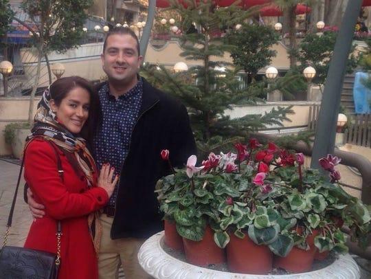 Solmaz Behzadpour, an Iranian citizen, with her husband,