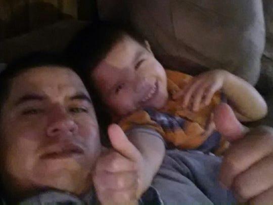 Antonio Cuahua, 35, takes a selfie with his youngest son Enrique, 5.