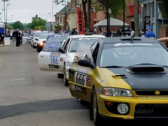 Rally cars line up along Second Street for residents to get a closer look at them during the inaugural Southern Ohio Forest Rally. This year's event will be May 16, 17 and 18.