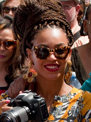 Beyonce with camera on tour of Old Havana, Cuba, April 4, 2013.