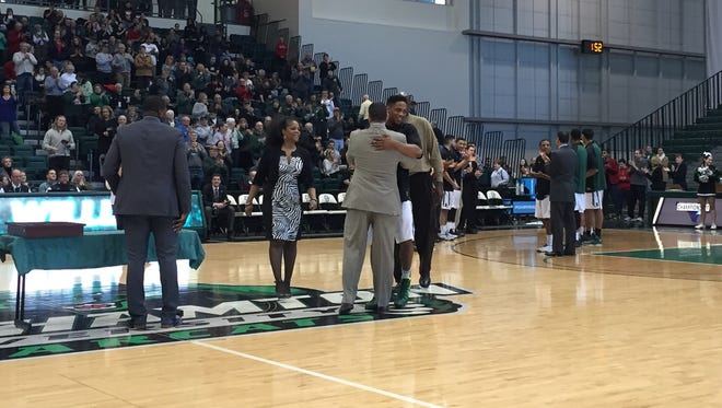 Binghamton University senior forward Jabrille Williams hugs coach Tommy Dempsey during the Senior Day ceremony prior to Saturday's game at the Events Center.
