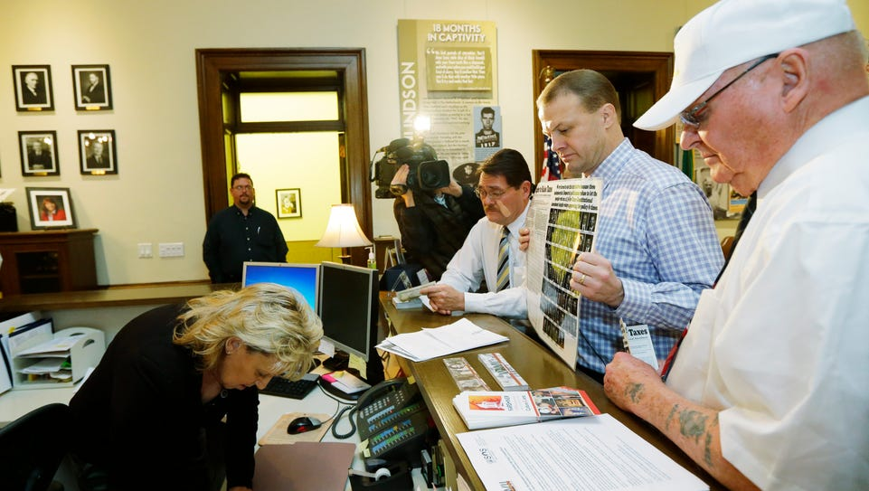 Initiative promoter Tim Eyman, second from right, files