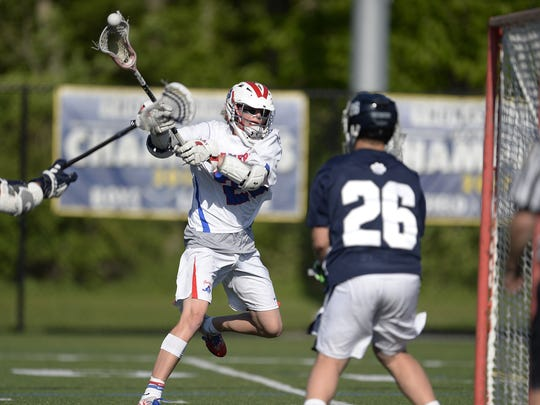 Fairport's Klay Stuver, left, scores on Pittsford goalie Brecken Catalano for the Red Raiders fourth goal during a Section V Class A semifinal last May. Stuver scored 46 goals last season.
