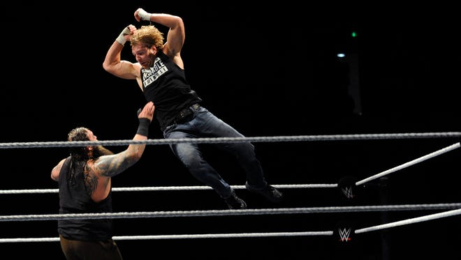 Dean Ambrose leaps onto Bray Wyatt during the WWE Wrestling event at Garrett Coliseum in Montgomery, Ala. on Saturday January 10, 2015.