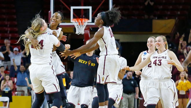Arizona State Sun Devils celebrates their 57-54 win against Arkansas Little Rock Trojans in their second round of the NCAA Division I Women's Basketball Tournament  game Monday, March 23, 2015 in Tempe, Ariz.