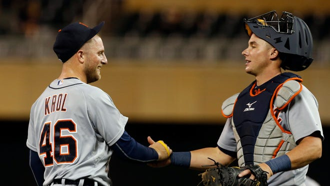 Detroit Tigers pitcher Ian Krol, left, and catcher James McCann celebrate the final out as the Tigers beat the Minnesota Twins 7-4 in 12 innings on Sept. 16, 2015. Krol pitched three scoreless innings.
